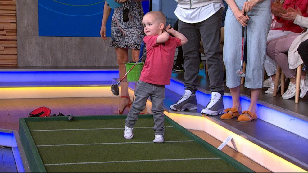 Two-and-a-half-year-old golf prodigy takes after his hero Tiger Woods