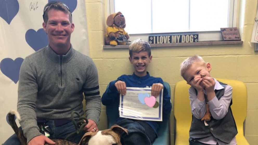 Boy gets adopted on the same day his family adopts a dog