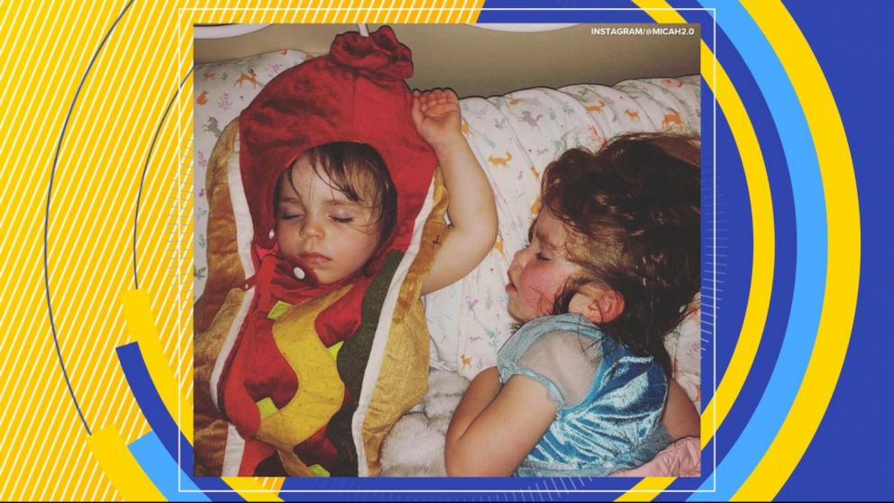 Dad cracks up as his 2-year-old wears a hot dog costume to bed