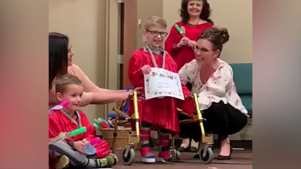 Boy with spina bifida shines as he walks for first time at preschool graduation