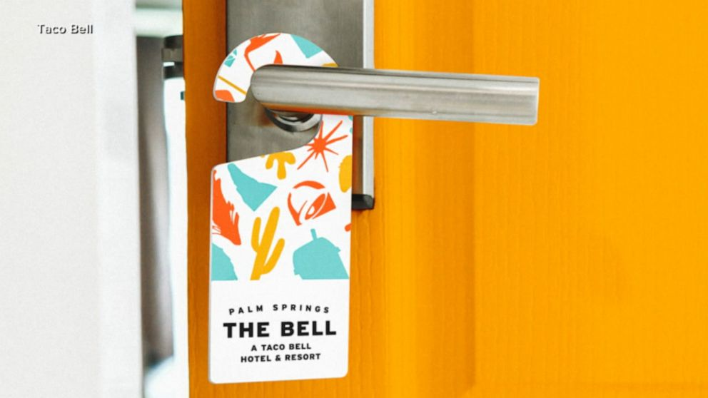 Taco Bell cuts a ceremonial ribbon made from hot sauce packets
