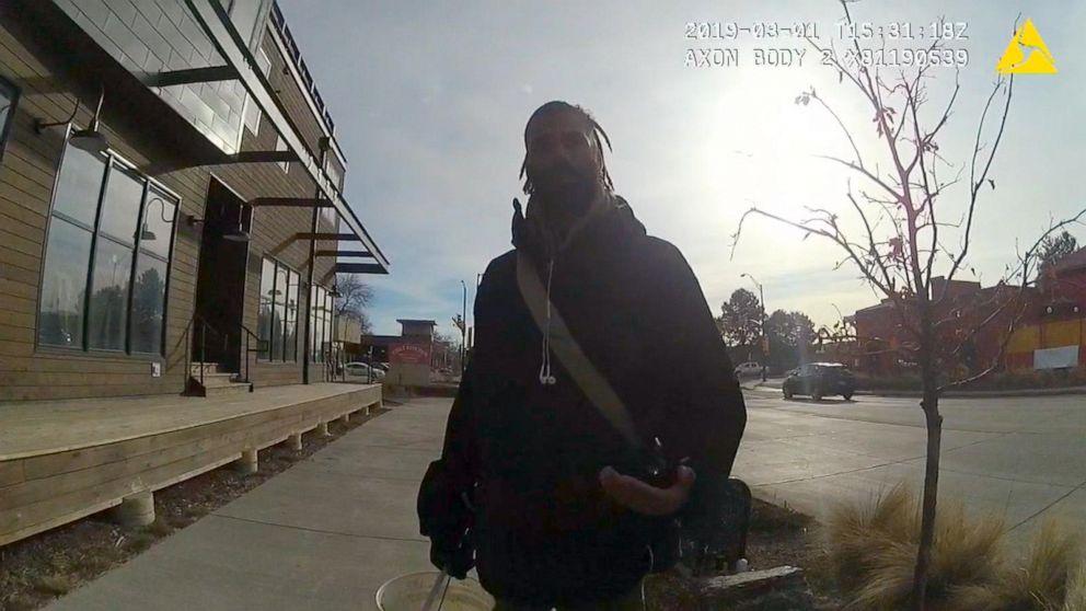 Colorado police officer who pulled gun on black man picking