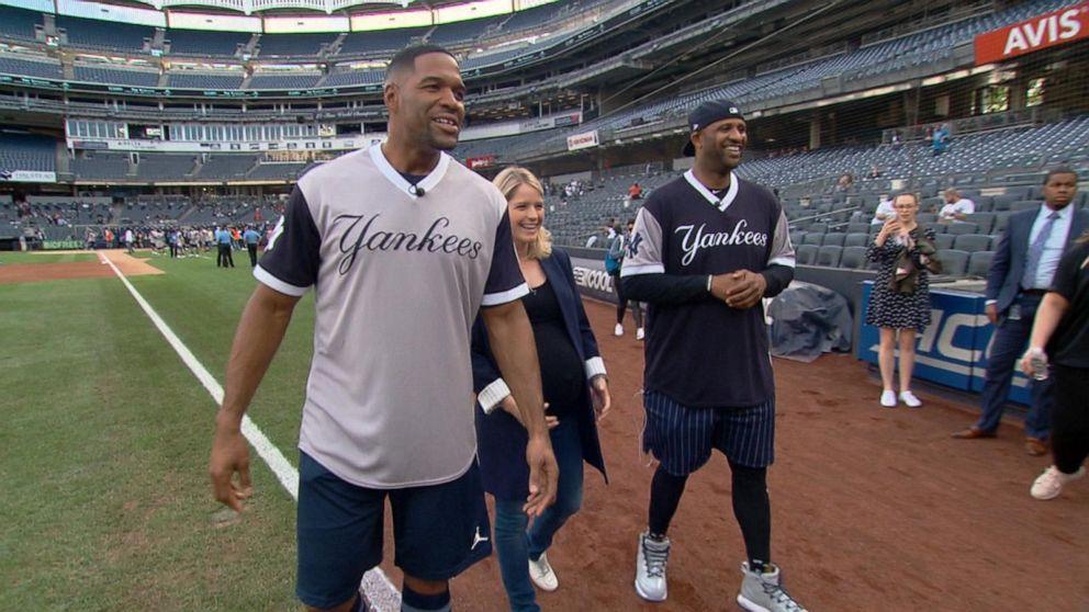 Michael Strahan coaches kids for charity softball game at Yankee Stadium