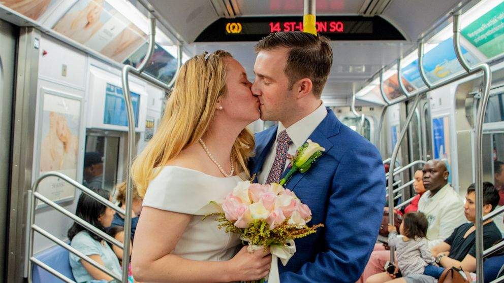 The next stop is...marriage: Military couple weds on New York City subway