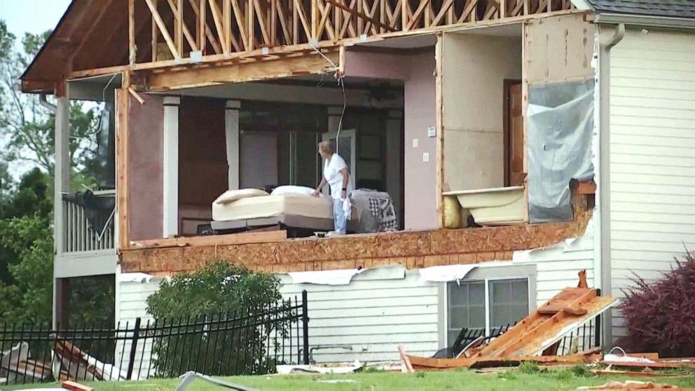 Powerful EF4 tornado rips through Kansas, injures 18 and shuts down airport