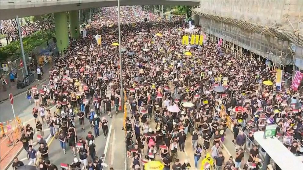 1 protester dead, 82 injured as demonstrators fill the streets of downtown Hong Kong