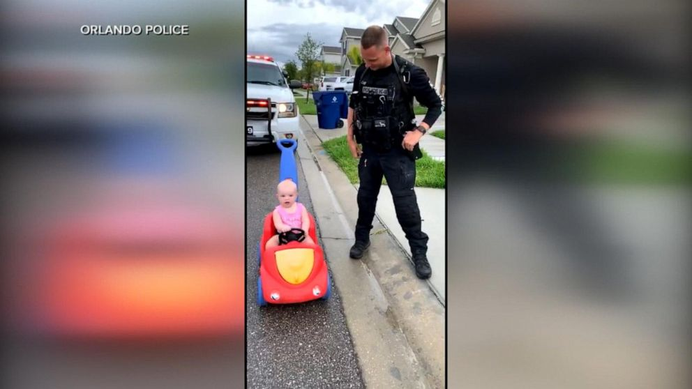 Little girl 'pulled over' by her police officer dad