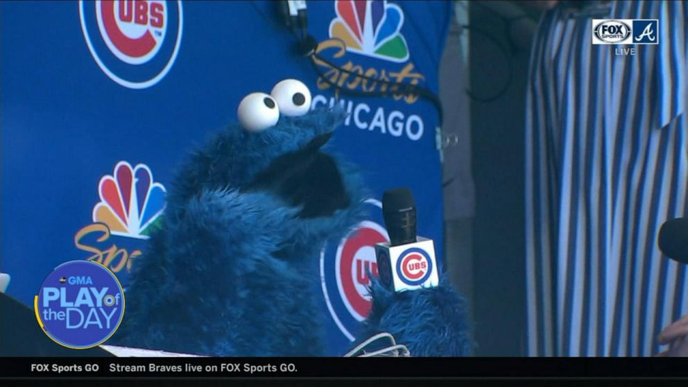 Cookie Monster sings during 7th-inning stretch at Cubs game