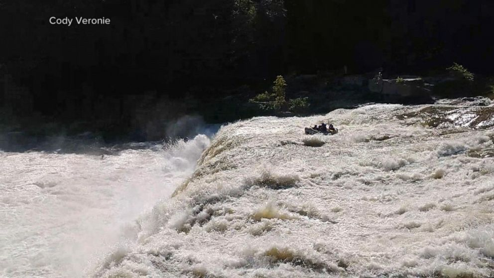 6 people rescued after raft tumbles over waterfall
