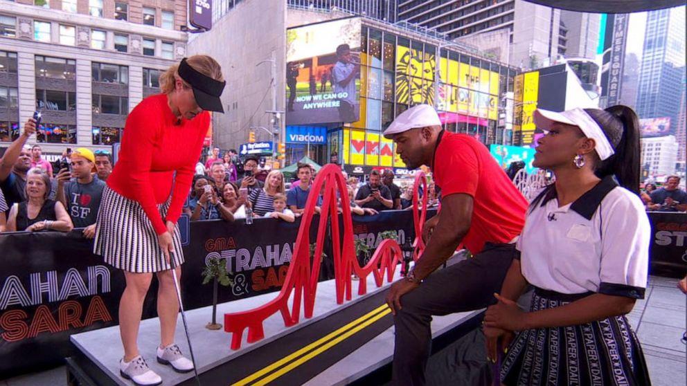 Michael, Sara and Keke play mini golf in Times Square