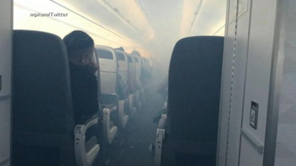 7 hospitalized after smoke fills crowded flight
