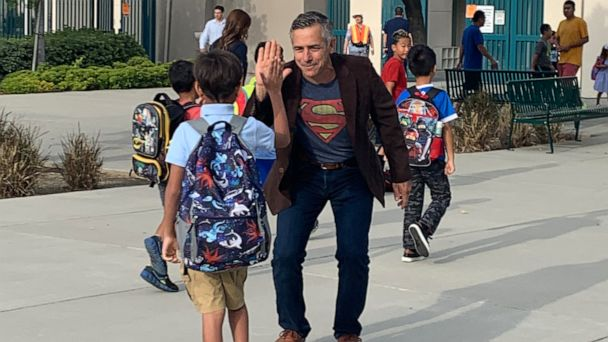 Principal who accepted 'air hugs' during chemo returns to greet kids  cancer-free