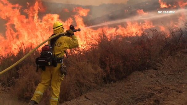 Southern California wildfire closes in on homes