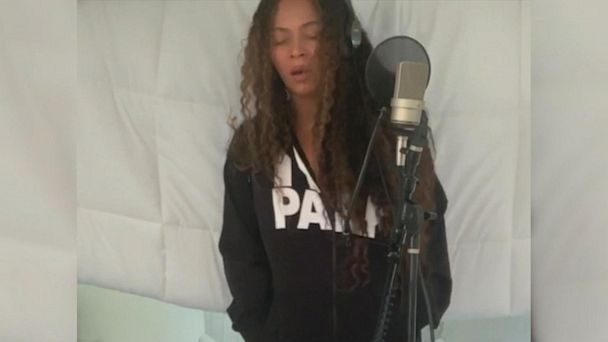 Beyonce records music for new 'Lion King' in exclusive clip