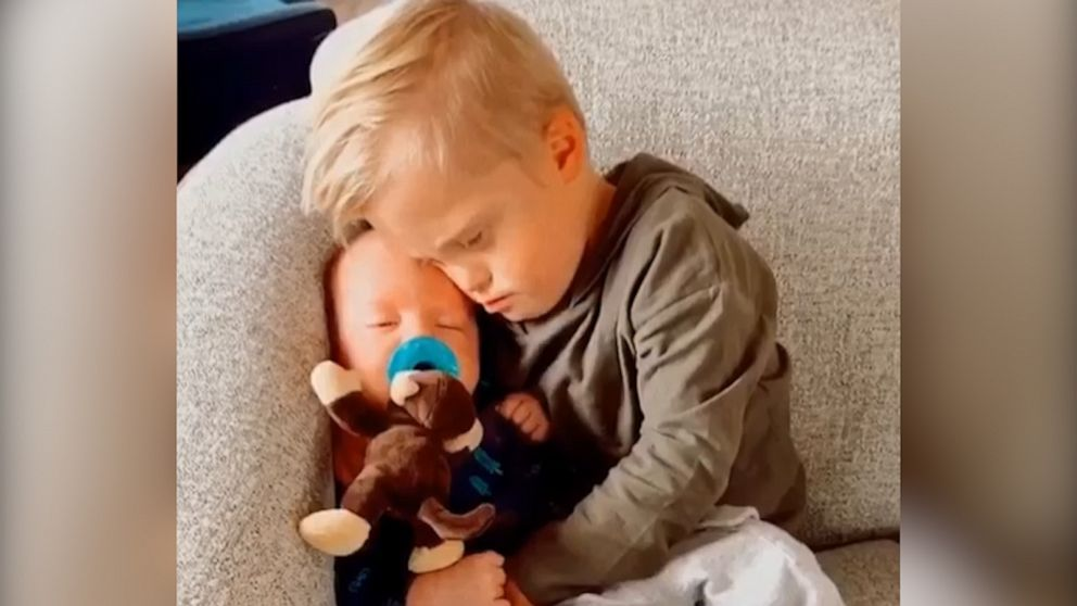 This toddler comforting his baby brother is too cute