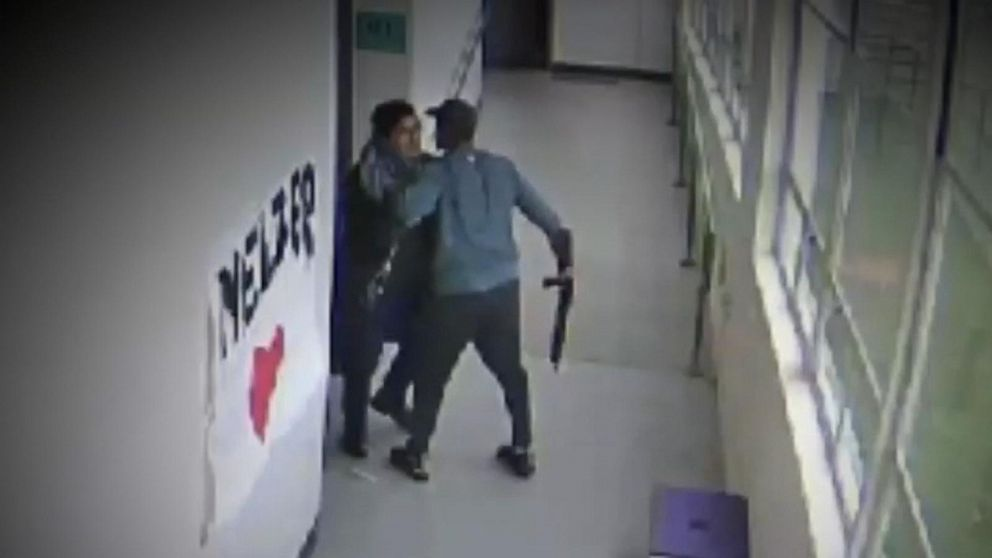 Hero coach confronts student with a gun