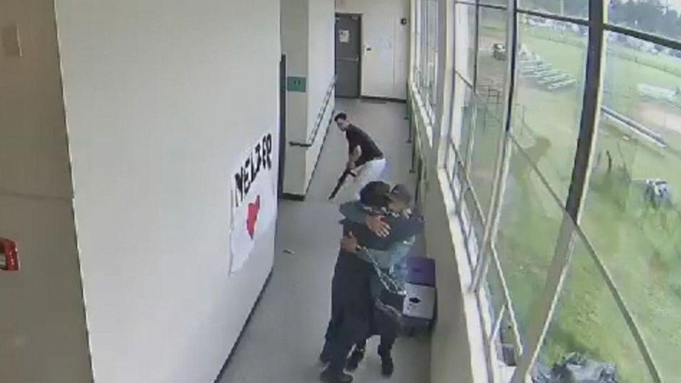 High school coach disarms student armed with shotgun