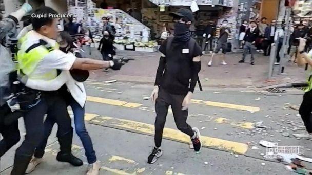 Police open fire on Hong Kong demonstrators