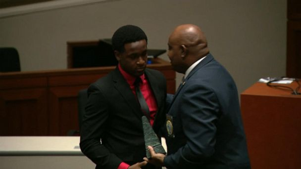 Man honored for ethical bravery after hugging cop who killed his brother