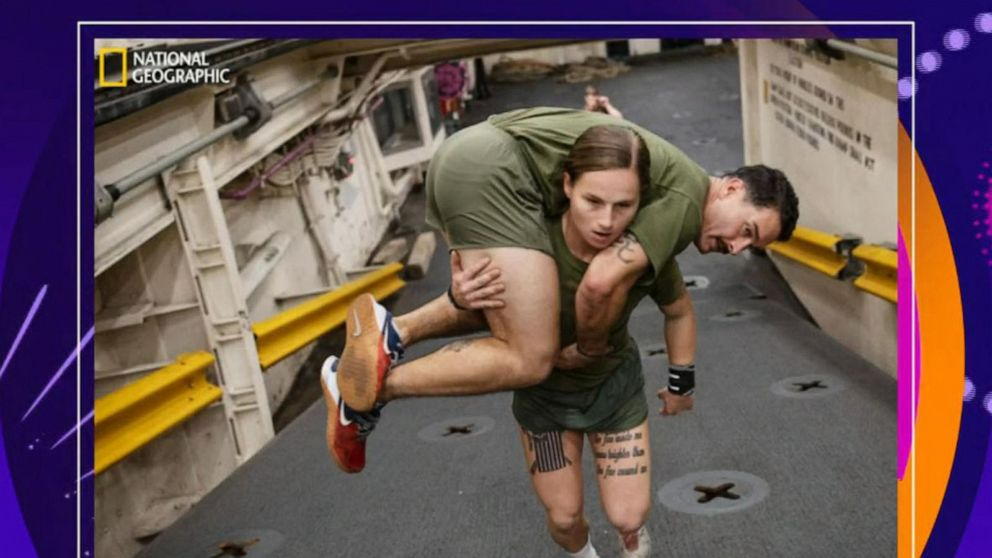 The story behind the moving photo of a female Marine carrying her male counterpart
