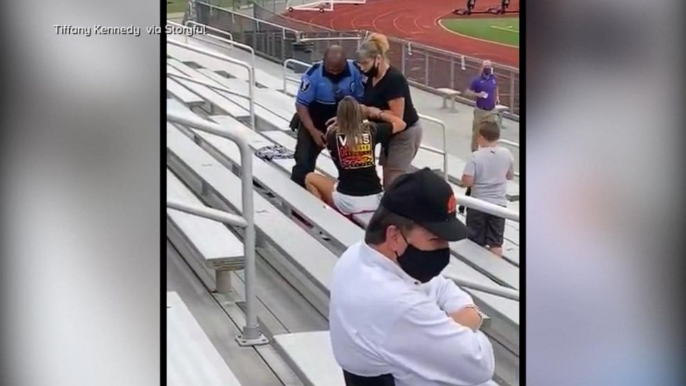Officer tases, arrests woman for not wearing a mask at football game