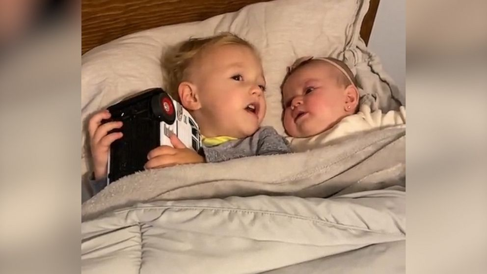 VIDEO: Toddler adorably calms baby sister in viral video