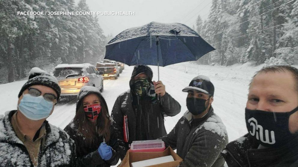 Drivers stranded in snowstorm get leftover COVID-19 vaccines