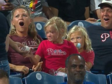 WATCH:  Fan gives foul ball to young girl