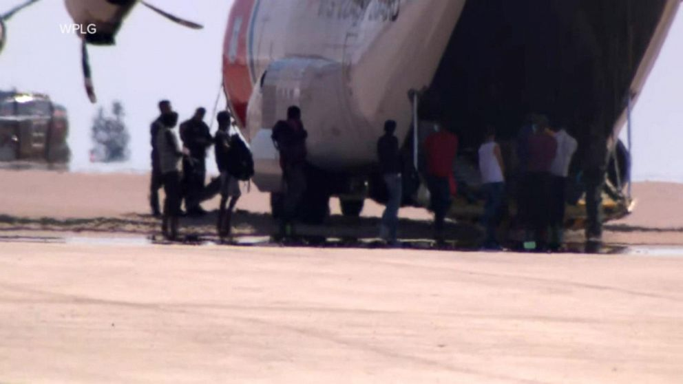 Authorities begin deporting planes full of migrants from Texas