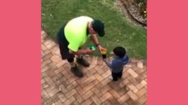 Video Sanitation worker gives toys to little boy who thanked him