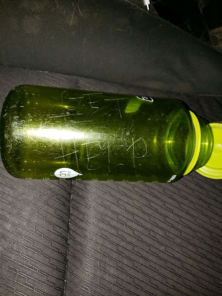 PHOTO: Curtis Whitsons green Nalgene bottle that said GET HELP.