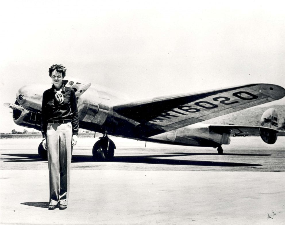 PHOTO: Amelia Earhart stands in front of the Lockheed Electra in which she disappeared in 1937.