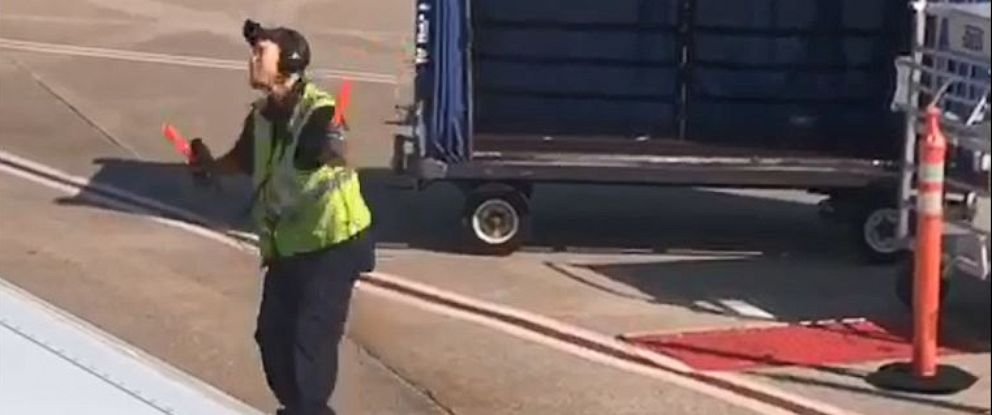 PHOTO: An airline worker at Nashville International Airport was seen dancing on the tarmac.