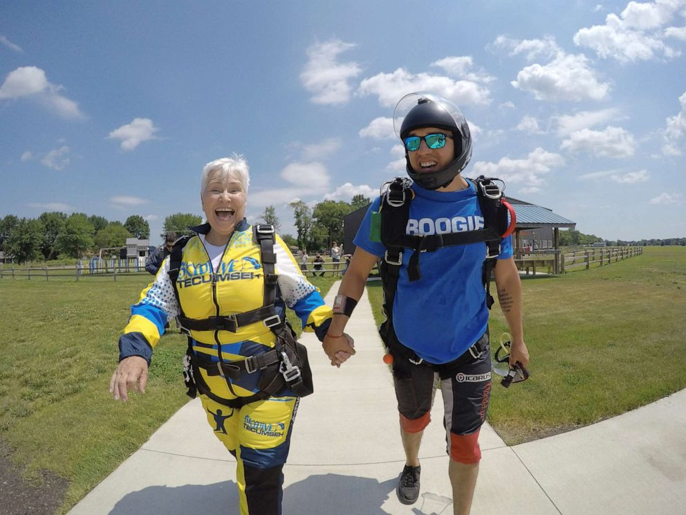 PHOTO: Beverly Mylek, 78, walking to the plane she will jump from momentarily.