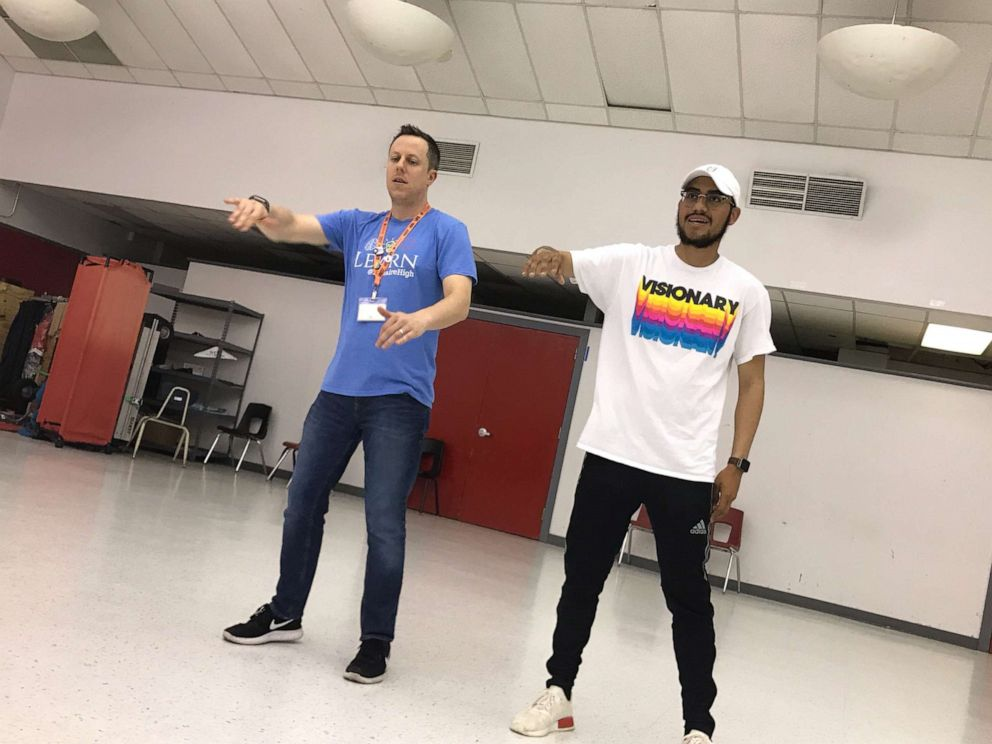 PHOTO: Dr. Trevor Boffone, a Spanish teacher at Bellaire High School in Bellaire, Texas, dances with Wilson Barrera.