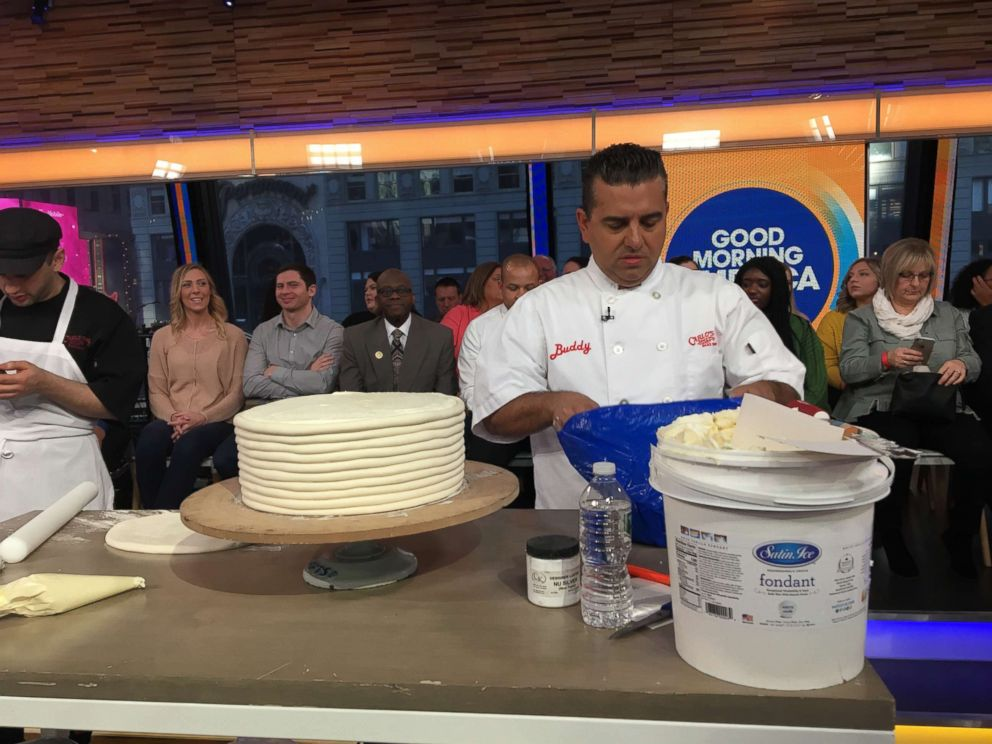 PHOTO: Buddy Valastro puts together his breakfast-inspired cake on GMA.