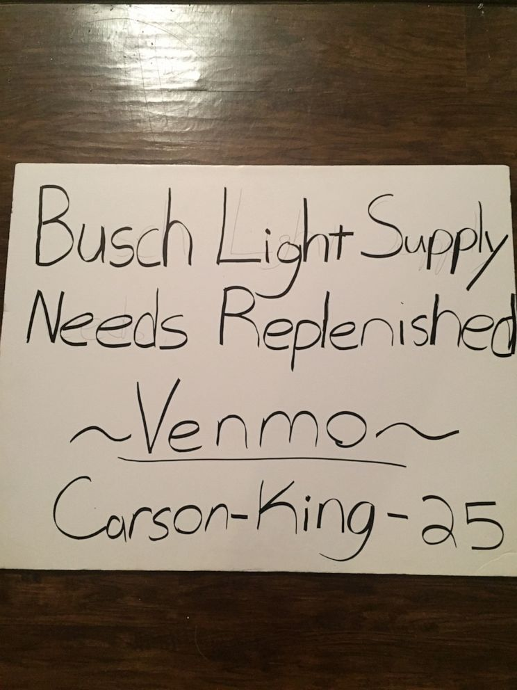 PHOTO: Carson King waved a sign that read Busch Light Supply Needs Replenished during ESPNs College GameDay.