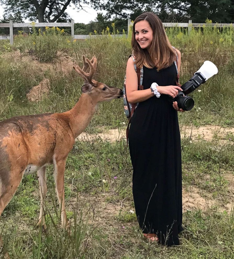 PHOTO: Photographer Laurenda Marie poses next to the deer that surprised her while she was taking wedding photos for the Mackleys.