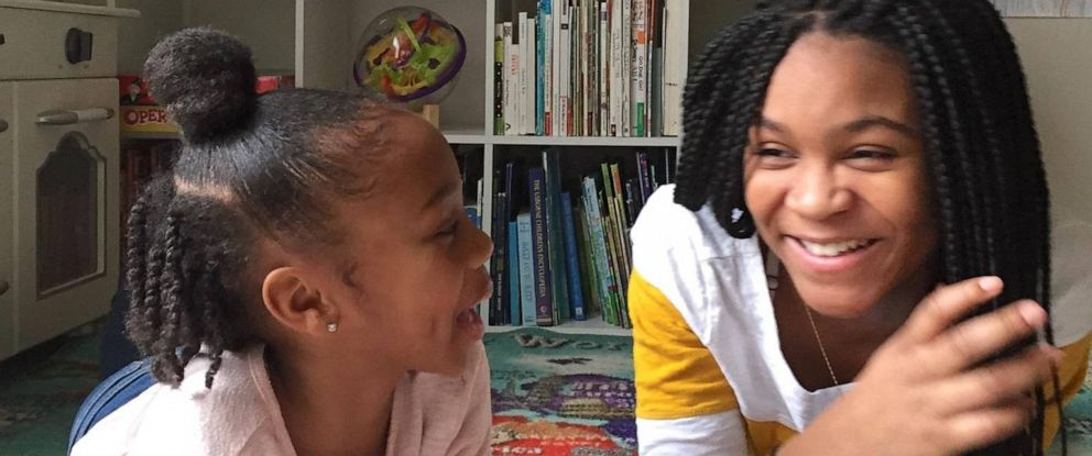 PHOTO: Two sisters share their love of books by reading bedtime stories to kids live on social media.