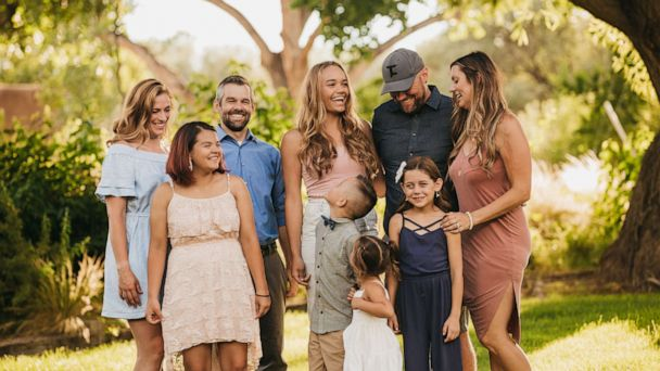Party of 6! Couple agrees to adopt sisters and finds out they're