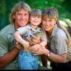 """Crocodile Hunter"" Steve Irwin with his wife Terri Irwin, and daughter Bindi Irwin, and a baby crocodile at Australia Zoo in Queensland, Dec. 14, 2002."