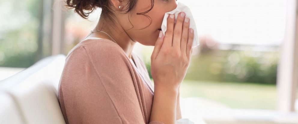 PHOTO:A woman blows her nose in this undated stock photo.