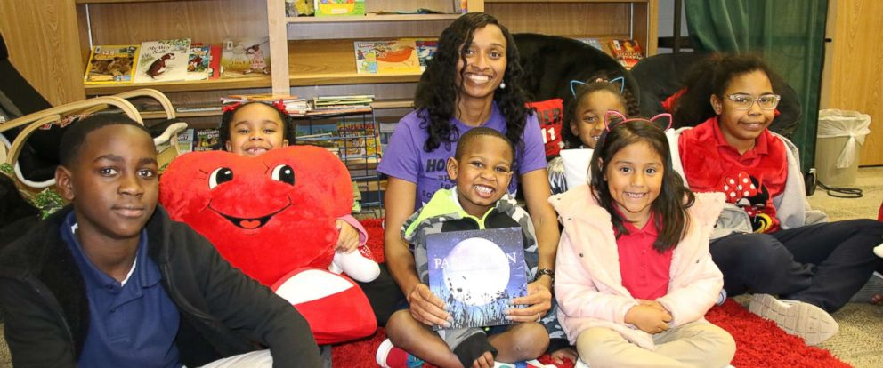 PHOTO: Dr. Belinda George reading to Homer Drive Elementary School students.