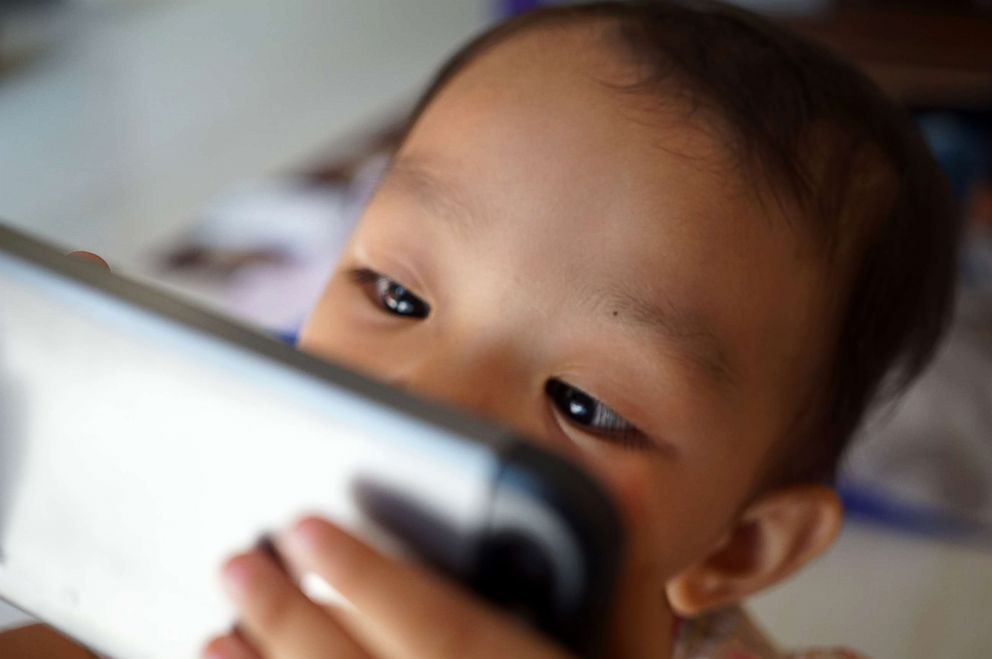 PHOTO: A baby plays with a smart phone in this undated stock photo.