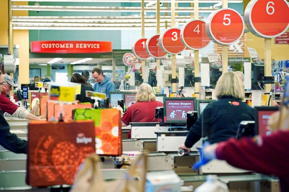 Cashiers ring out customers at the Hannaford supermarket in Scarborough on Friday, March 27, 2020. Hannaford stores installed plexiglass barriers at cash registers as a safety precaution. (Staff Photo by Gregory Rec/Portland Press Herald via Getty Images)