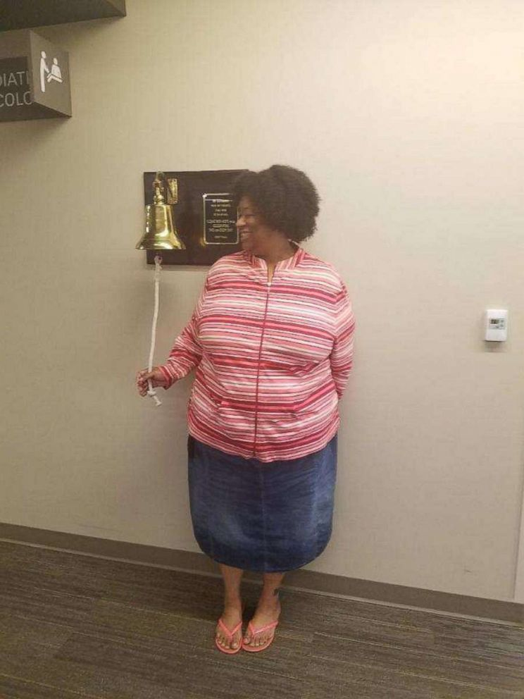 PHOTO: Keasha Hawkins rings a bell when she completed radiation on June 12, 2018.