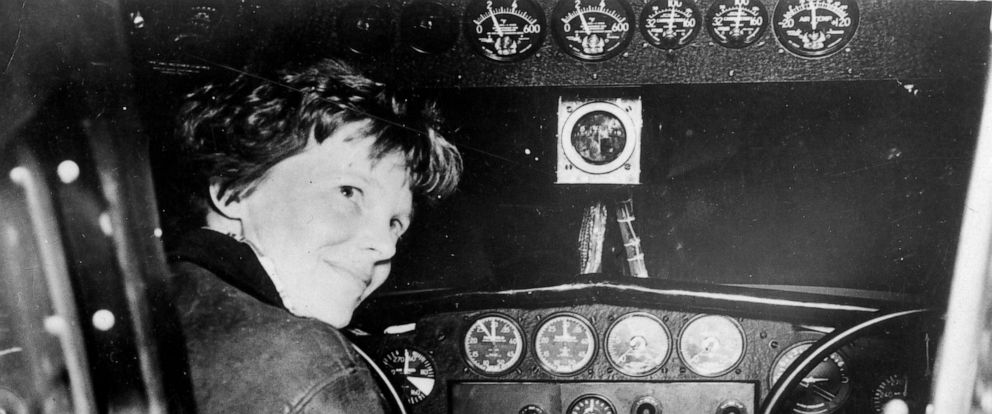 PHOTO: Amelia Earhart in the cockpit of a plane.