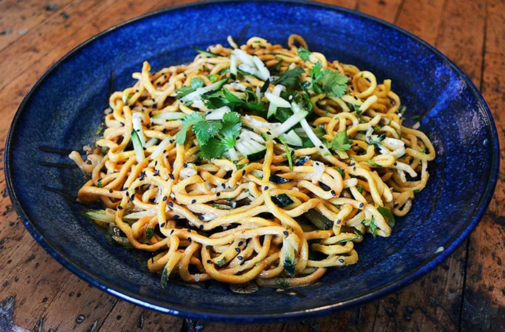 PHOTO: Peanut-sesame noodles topped with fresh cilantro, scallions and cucumbers.