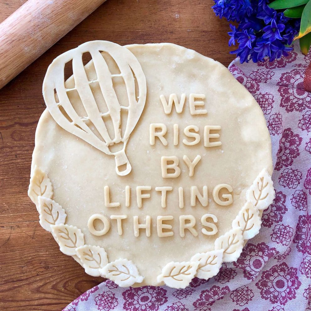 A pie crust with an uplifting message made by Marie Saba.