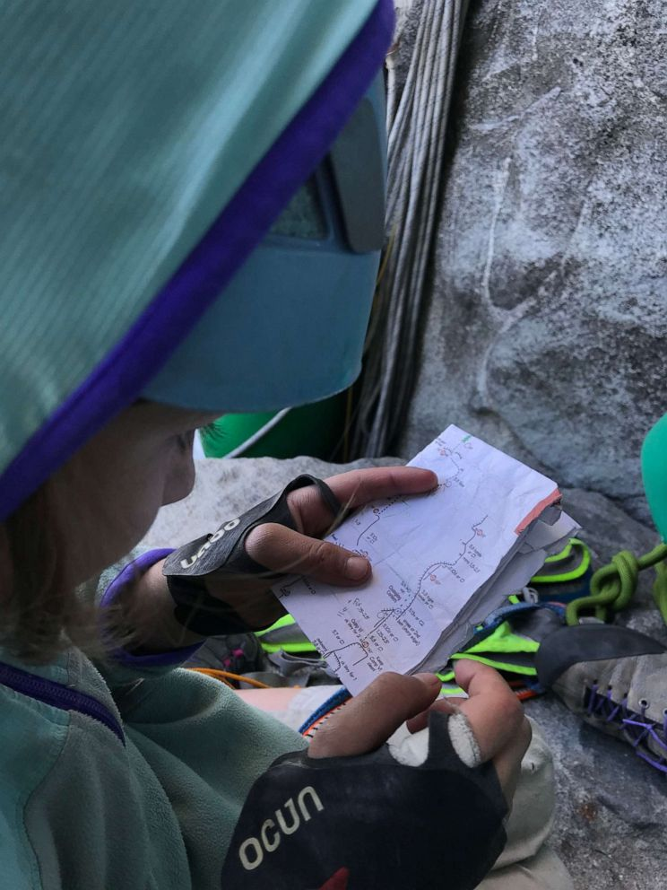 PHOTO: Selah Schneiter looks at her notes as she climbs El Capitan at Yosemite National Park in California.